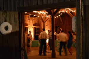 Indoor rustic event with string lighting